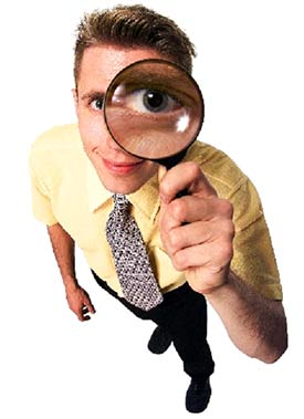 Image of a man looking through a spy glass.
